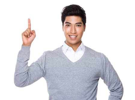 Businessman with finger point upwards photo