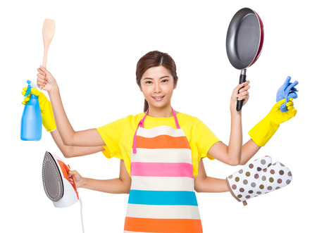plastic glove: Multitasking housewife Stock Photo