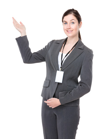 Businesswoman with hand present photo