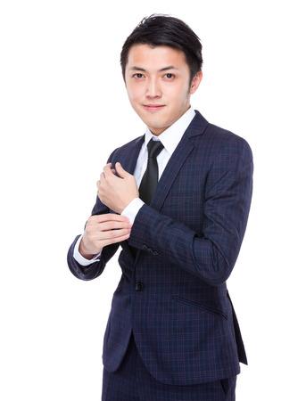 cufflinks: Businessman adjust with his cufflinks Stock Photo