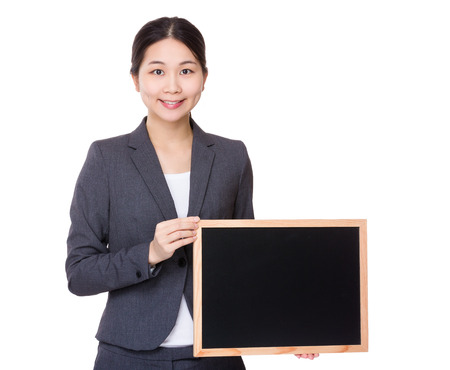 Businesswoman hold with blackboard photo