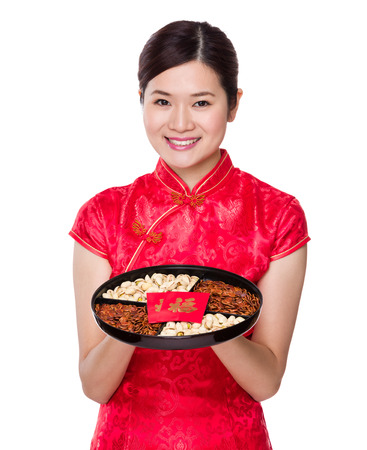 Chinese woman hold with snack tray for lunar new year 版權商用圖片