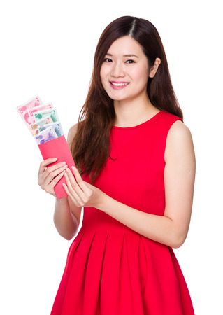 rmb: Woman hold lucky money with RMB Stock Photo