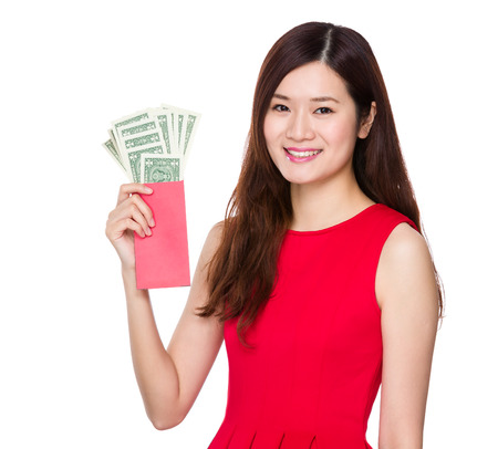 usd: Woman hold red pocket with USD