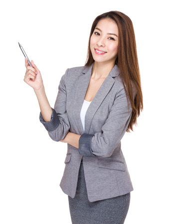 sell out: Business woman with pen up