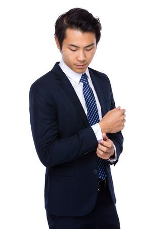 adjust: Businessman adjust his cufflink Stock Photo