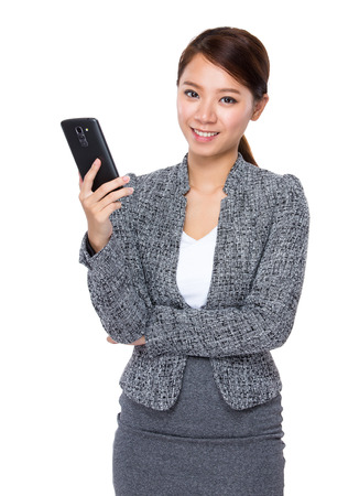 Businesswoman use of mobile phone photo