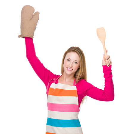 hold up: Housewife hold up with gloves and spatula