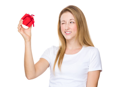 blink: Woman hold with small gift and show with blink eye Stock Photo