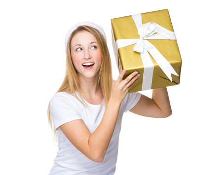 guess: Xmas woman guess the present in box Stock Photo