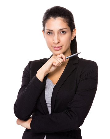 Businesswoman with pen point up photo