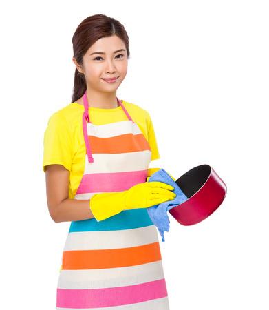 saucepan: Housewife wash saucepan Stock Photo