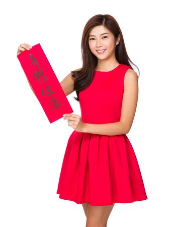 chun: Woman hold with Fai Chun for chinese new year, phrase meaning is blessing for good health