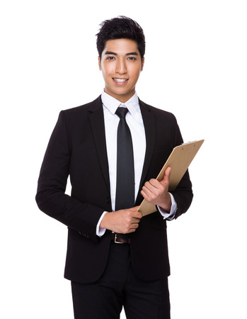 jefe: Asimiento del hombre de negocios de Asia con el portapapeles Foto de archivo