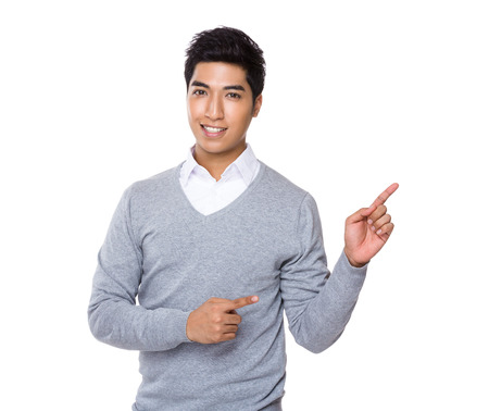 Businessman with finger point aside photo