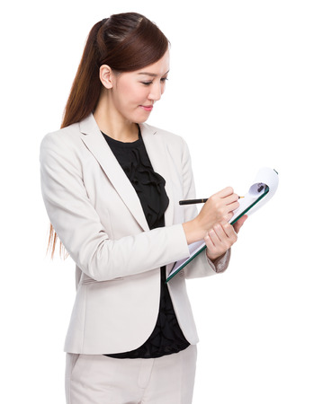 write background: Businesswoman write on clipboard