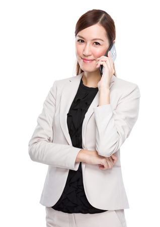 chinese people: Businesswoman talking by cellphone Stock Photo