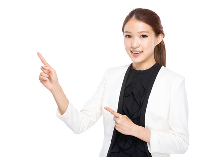 real esate: Businesswoman use two finger point up Stock Photo