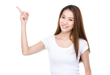 Mujer asiática con el dedo hasta el punto Foto de archivo - 36470729