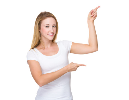 Woman with two finger point up photo