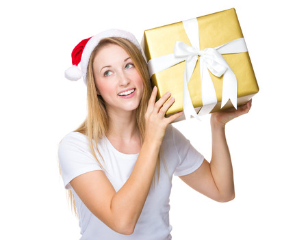 Xmas woman guess the gift in box Stock Photo