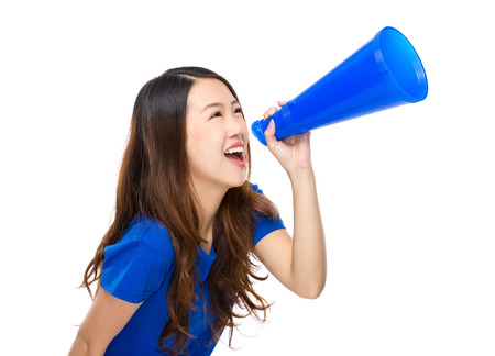 excite: Excite woman shout with megaphone Stock Photo