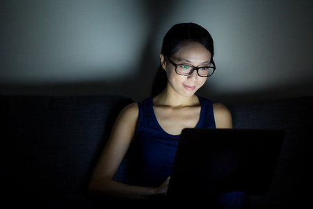 Woman use laptop computer at night photo
