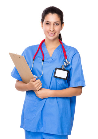Doctor woman with clipboard photo