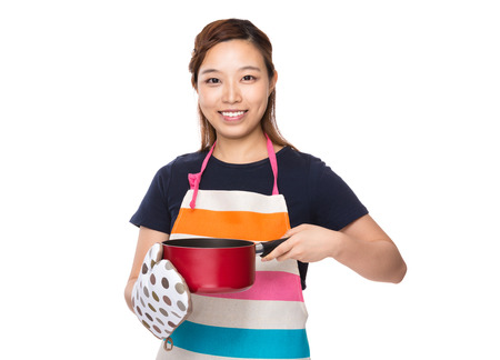 housewife gloves: Housewife holding saucepan with oven gloves