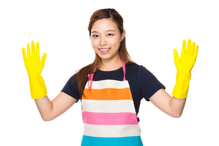 housewife gloves: Housewife with plastic gloves and showing out Stock Photo