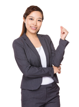 Asian Businesswoman with hand snapping photo