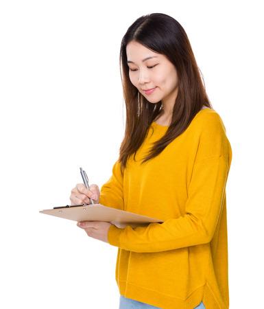 take a note: Woman take note on clipboard