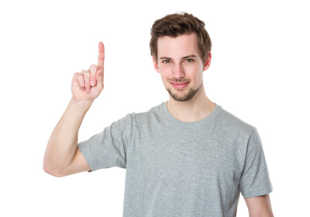 Young man with finger point upwards