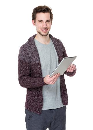 Caucasian man use of digital tablet photo