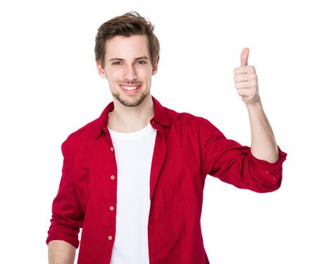 親指のアップを持つ男 写真素材