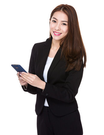 Asian businesswoman hold with the mobile phone photo