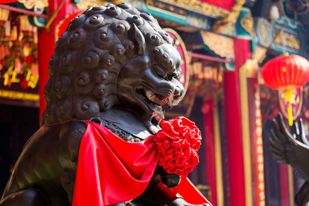 Lion statue in Chinese temple photo