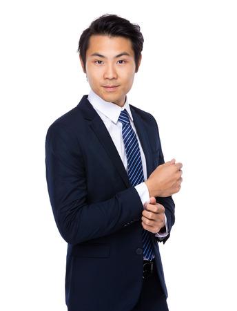 adjust: Businessman adjust his suit sleeve