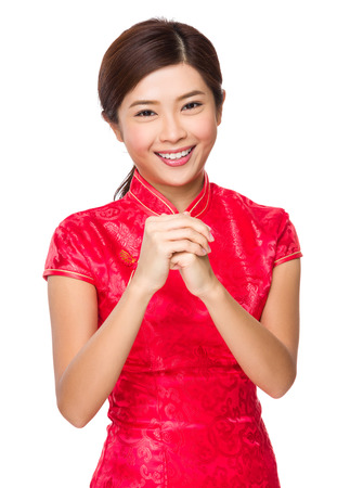 Chinese woman with blessing gesture for lunar new year photo