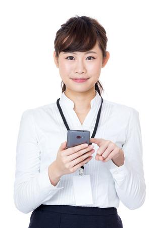 Asian business woman touching mobile photo