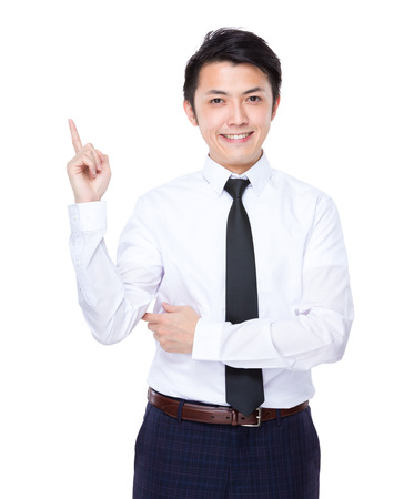 Business man with finger point up photo