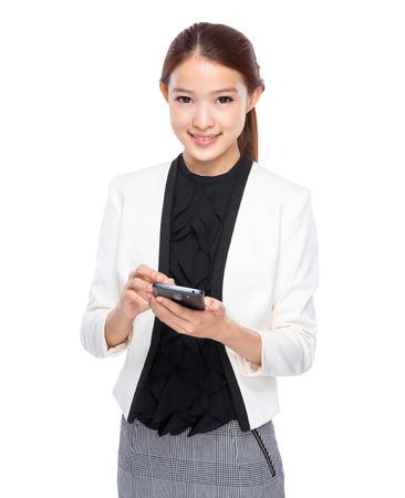 Businesswoman use cellphone Stock Photo