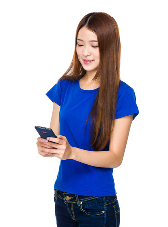 Woman texting with smartphone photo