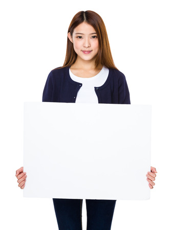 woman holding sign: Asian woman showing banner