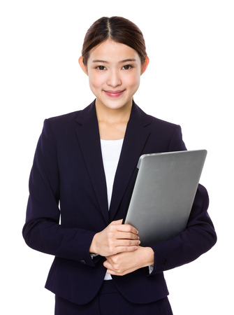 Attractive smiling young business woman holding laptop computer photo