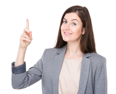 Businesswoman with finger point up photo