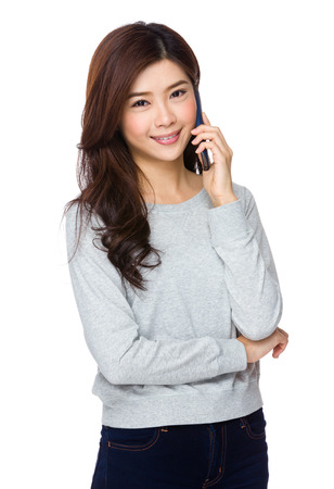 Young woman smiling and talking on her cell phone photo