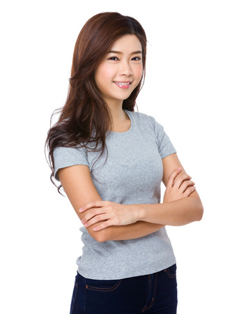casual attire: Young woman in casual attire looking and smiling Stock Photo