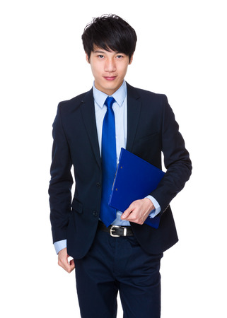 chinese businessman: Confident relaxed Asian businessman standing with a folder Stock Photo