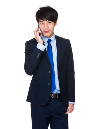 Young Business Man happy Speaking mobile phone photo